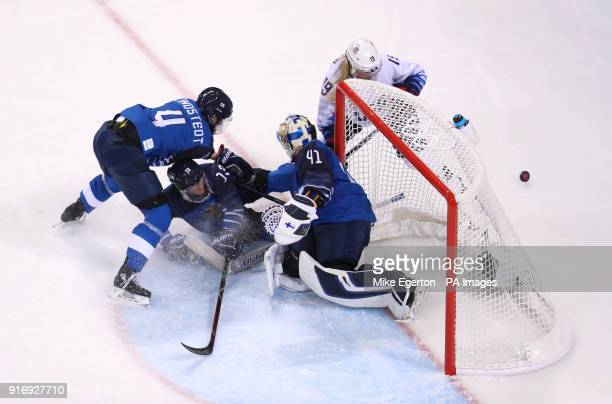 Finland keeper Noora Rate saves from USA's Gigi Marvin in the women's Ice Hockey Preliminary Round during day two of the PyeongChang 2018 Winter...