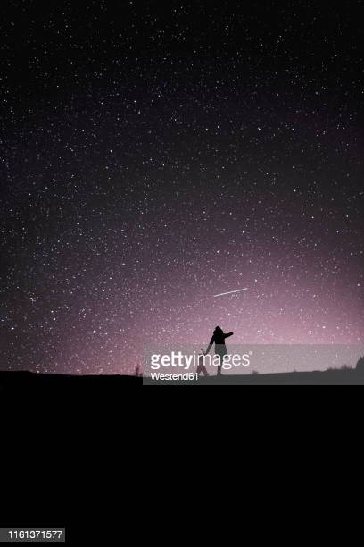 finland, kuopio, mother and daughter watching shooting star - daughters of darkness stock pictures, royalty-free photos & images