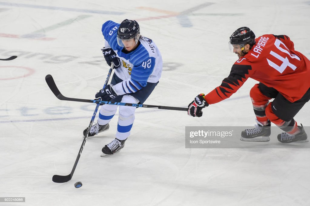 Finland men's hockey defender Heiskanen Miro (42) looks to pass as Canada men's hockey forward Maxim Lapierre (40) defends during the men's hockey semi final game between Canada and Finland during the 2018 Winter Olympic Games at the Gangneung Hockey Center on February 21, 2018 in PyeongChang, South Korea. Canada advances to the gold medal game with 1-0 victory.