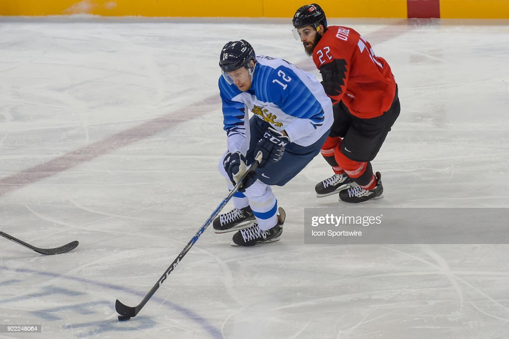 Finland men's hockey forward Anttila Marko (12) looks to pass as Canada men's hockey forward Eric O'Dell (22) defends during the men's hockey semi final game between Canada and Finland during the 2018 Winter Olympic Games at the Gangneung Hockey Center on February 21, 2018 in PyeongChang, South Korea. Canada advances to the gold medal game with 1-0 victory.