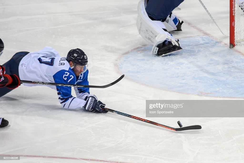 Finland men's hockey forward Kontiola Petri (27) makes a diving save in front of the Finland goal during the men's hockey semi final game between Canada and Finland during the 2018 Winter Olympic Games at the Gangneung Hockey Center on February 21, 2018 in PyeongChang, South Korea. Canada advances to the gold medal game with 1-0 victory.