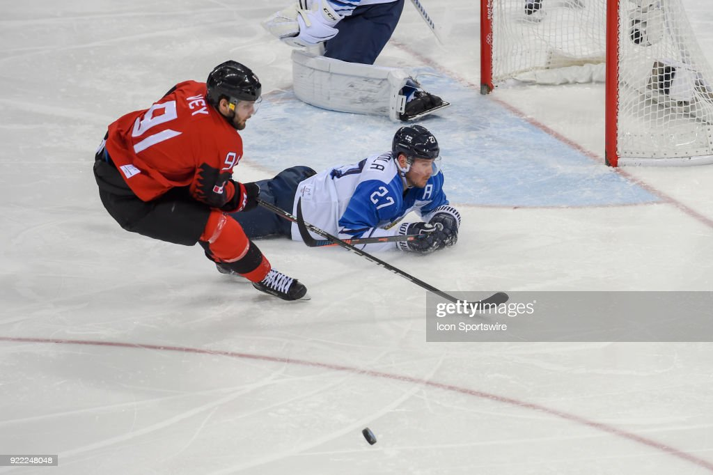 Finland men's hockey forward Kontiola Petri (27) makes a diving save in front of the Finland goal as Canada men's hockey forward Linden Vey (91) chases the loose puck during the men's hockey semi final game between Canada and Finland during the 2018 Winter Olympic Games at the Gangneung Hockey Center on February 21, 2018 in PyeongChang, South Korea. Canada advances to the gold medal game with 1-0 victory.