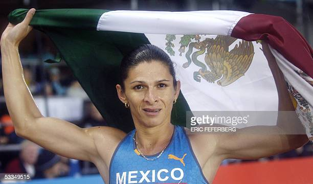 Mexican bronze medalist Ana Guevara celebrates after the women's 400m final at the 10th IAAF World Athletics Championships in Helsinki 10 August 2005...