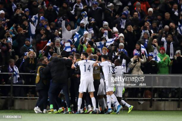 Finland players celebrate after Teemu Pukki of Finland scored a goal to make it 2-0 during the UEFA Euro 2020 Qualifier between Finland and...