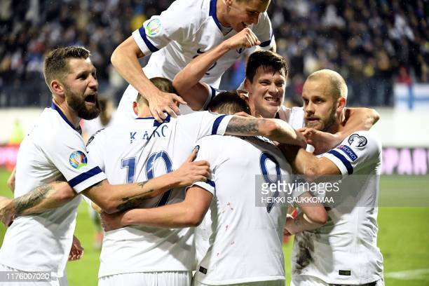 Finland players celebrates scoring the opening goal during the UEFA Euro 2020 Group J qualification football match Finland v Armenia in Turku,...