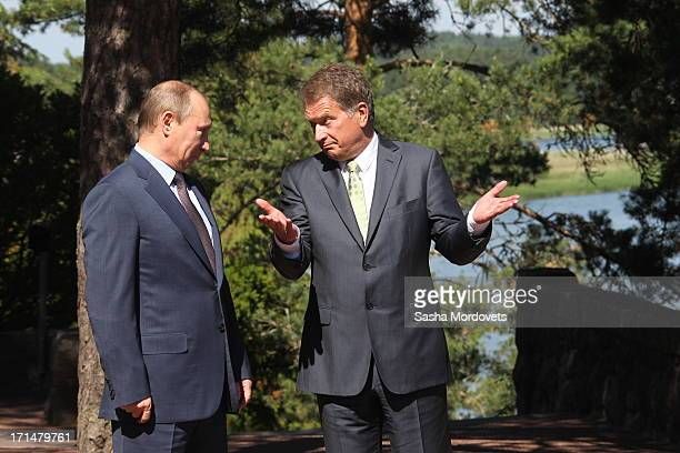 Finland President Sauli Niinisto receives Russian President Vladimir Putin in his summer residence Kultaranta June 25 2013 in Naantali Finland Putin...
