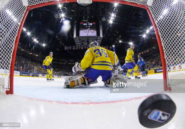 Finland scores past Sweden´s goalkeeper Henrik Lundqvist during the IIHF Men's World Championship Ice Hockey semi-final match between Sweden and...