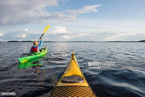 Finland, Southern Savonia, Oravi, Linnansaari National Park, boy kayaking on Lake Haukivesi