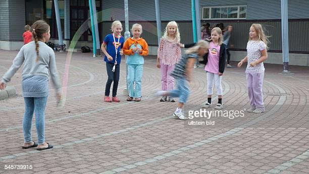Finland Turku Turku Waeinoe Aaltosen koulu children playing outdoors during a break