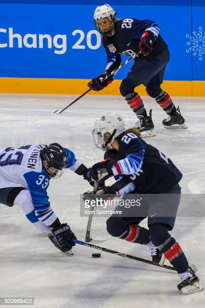 Finland Women's Hockey forward Michelle Karvinen attempts to break up a pass from US Women's Hockey forward Hannah Brandt from Vadnais Heights MN to...