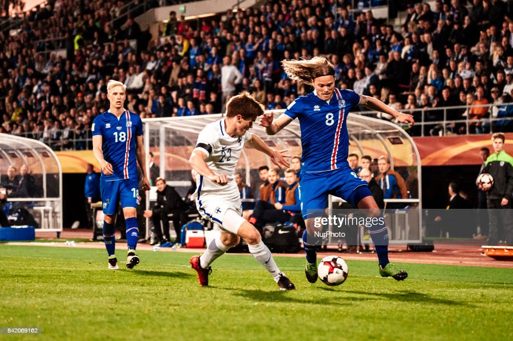 Finland's Albin Granlund and Iceland's Birkir Bjarnason during the FIFA World Cup 2018 Group I football qualification match between Finland and Iceland in Tampere, Finland, on September 2, 2017.