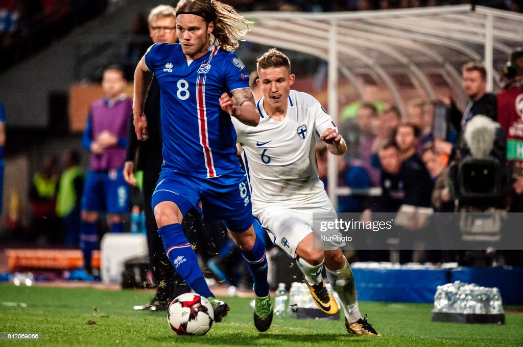 Finland's Alexander Ring chases Iceland's Birkir Bjarnason during the FIFA World Cup 2018 Group I football qualification match between Finland and Iceland in Tampere, Finland, on September 2, 2017.