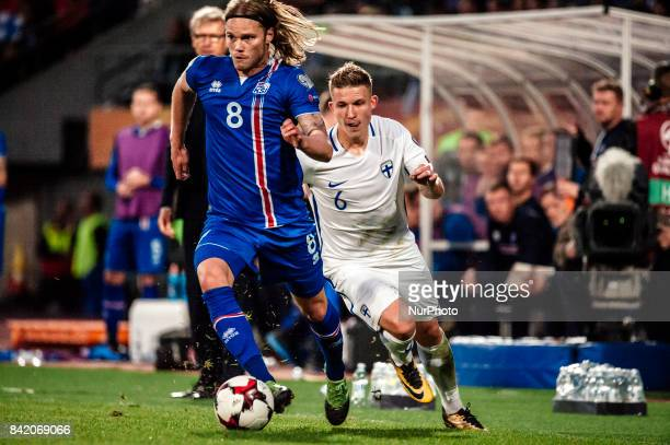Finland's Alexander Ring chases Iceland's Birkir Bjarnason during the FIFA World Cup 2018 Group I football qualification match between Finland and...