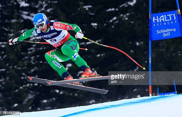 Finland's Andreas Romar takes part in the downhill event during the men's super combined at the 2013 Ski World Championships in Schladming Austria on...