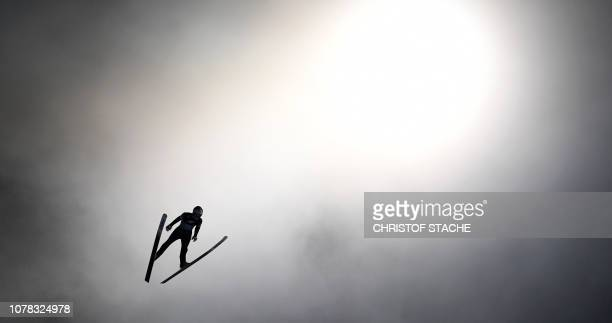TOPSHOT Finland's Antti Aalto soars through the air during his first competition jump at the fourth stage of the FourHills Ski Jumping tournament in...