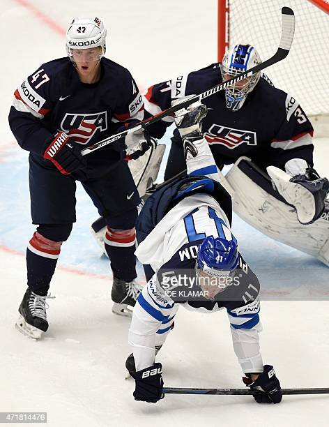Finland's Antti Pihlstrom and Torey Krug of US fight for space in front US goal during the group B preliminary round ice hockey match USA vs Finland...