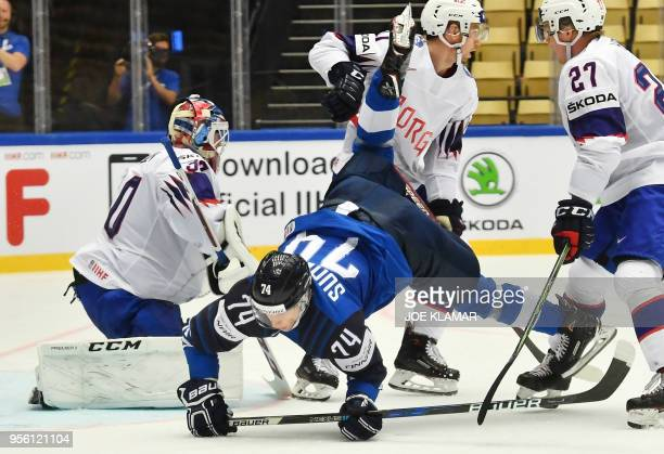 Finland's Antti Suomela falls down in front of Norway's goalkeeper Lars Haugen during the group B match Finland vs Norway of the 2018 IIHF Ice Hockey...