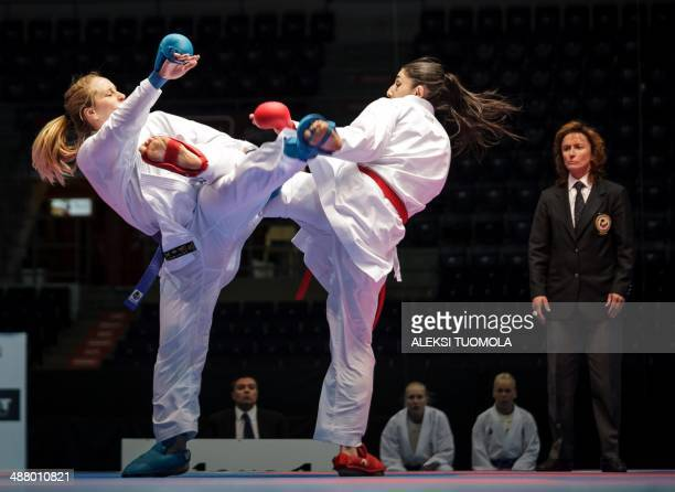 Finland's Ayse Abat fights with Merve Coban of Turkey during the women's Kumite team competition of the Karate European Champions on May 3 2014 in...