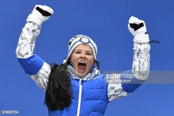 Finland's bronze medallist Krista Parmakoski poses on the podium during the medal ceremony for the cross country women's 10km Free at the Pyeongchang...