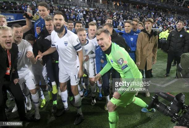 Finland's captain Tim Sparv and goalkeeper Lukas Hradecky celebrate with their team-mates after the UEFA Euro 2020 Group J qualification football...