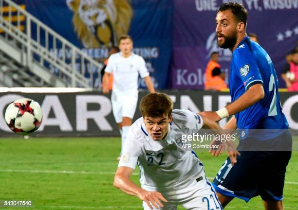 Finland's defender Albin Granlund vies with Kosovo's forward Atdhe Nuhiu during the FIFA World Cup 2018 qualification football match between Kosovo...