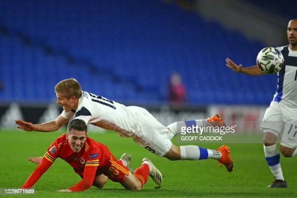 Finland's defender Jere Uronen is sent off for this foul on Wales' midfielder Harry Wilson during the UEFA Nations League group B4 football match...