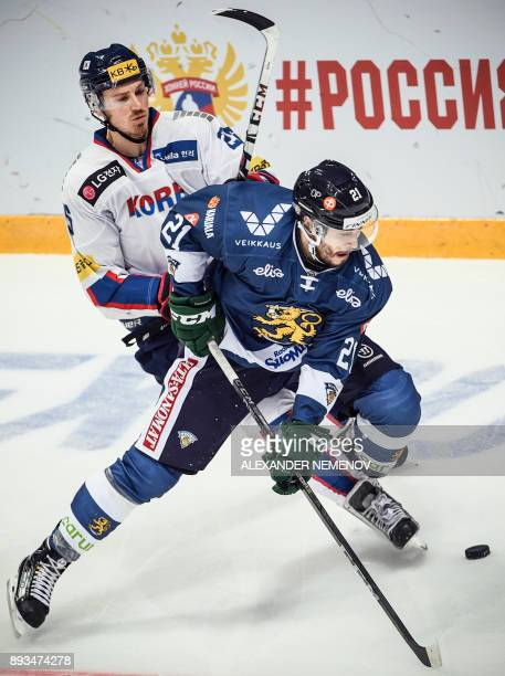 Finland's defender Jesse Virtanen fights for the puck with South Korea's forward Brock Radunske during the Channel One Cup of the Euro Hockey Tour...