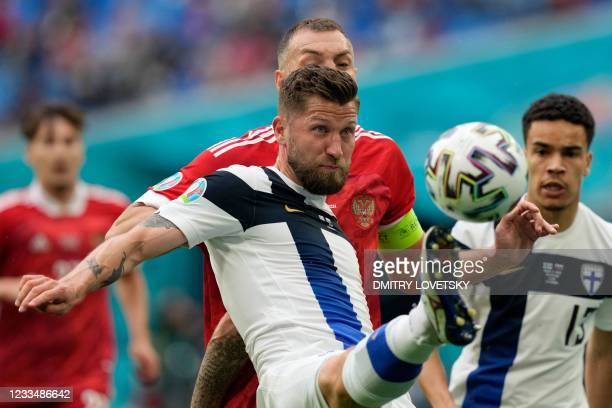 Finland's defender Joona Toivio and Russia's forward Artem Dzyuba vie during the UEFA EURO 2020 Group B football match between Finland and Russia at...