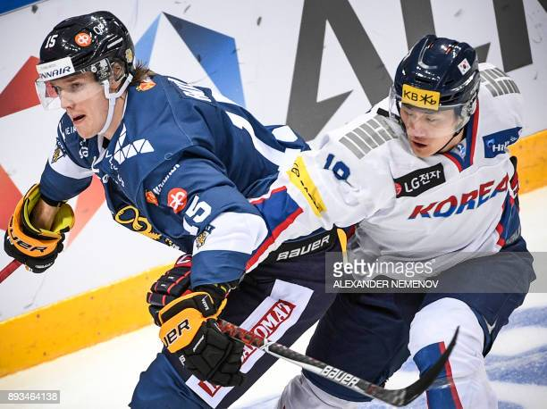 Finland's defender Juuso Riikola fights for the puck with South Korea's forward Sang Wook Kim during the Channel One Cup of the Euro Hockey Tour ice...