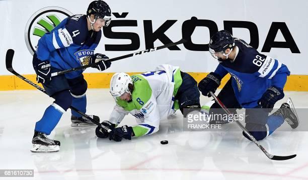 Finland's defender Mikko Lehtonen vies with Slovenian forward iga Jeglic during the IIHF Men's World Championship Finland vs Slovenia, group B ice...
