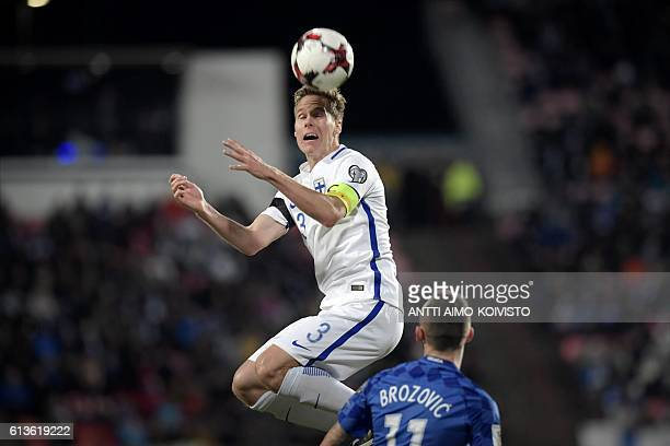 Finland's defender Niklas Moisander and Croatia's midfielder Marcelo Brozovic vie for the ball during the 2018 World Cup qualifier football match of...