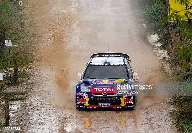 Finland's driver Mikko Hirvonen and codriver Jarmo Lehtinen compete with their Citroen Total WRT during the first stage of the 48th Rally of...