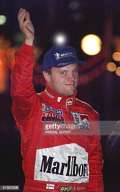 Finland's driver Tommi Makinen waves 22 January 2000 after the arrival of the 68th MonteCarlo rally Makinen and his codriver Risto Mannisenmaki won...