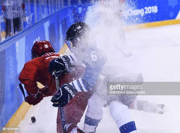 TOPSHOT Finland's Ella Viitasuo checks Russia's Yekaterina Smolina in the women's bronze medal ice hockey match between Finland and the Olympic...
