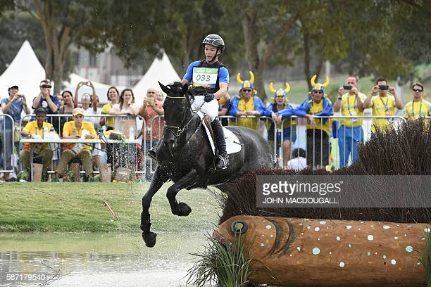 Finland's Elmo Jankari on Duchess Desiree stumbles on an obstacle as he competes in the Eventing's Individual Cross Country of the Equestrian during...