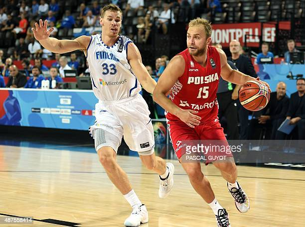 Finland's Erik Jay Murphy vies with Poland's Lukasz Koszarek during the group A qualification basketball match between Finland and Poland at the...