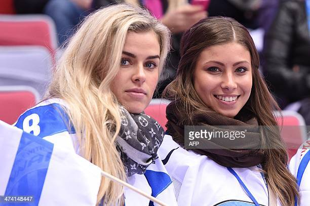 Finland's fans pose before the Men's ice hockey Bronze Medal Game USA vs Finland at the Bolshoy Ice Dome during the Sochi Winter Olympics on February...