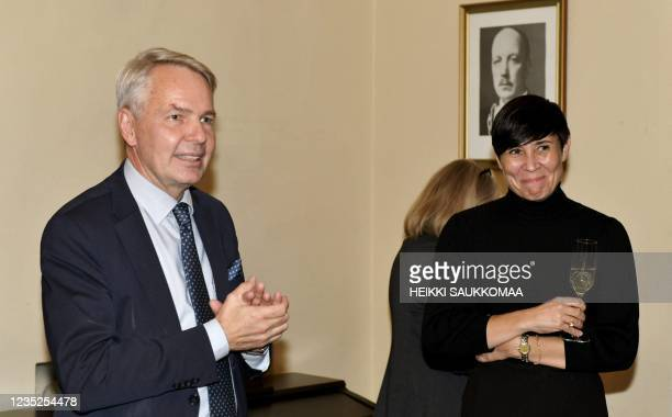 Finland's Foreign Minister Pekka Haavisto and Norway's Foreign Minister Ine Marie Eriksen Soreide attend a dinner after a meeting of foreign...