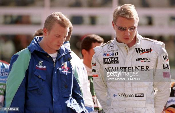 Finland's Formula One drivers Kimi Raikkonen and Mika Hakkinen during the minute's silence at Monza