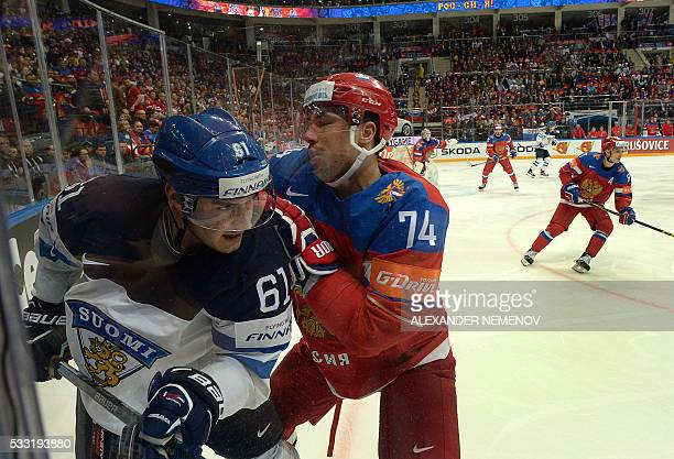 Finland's forward Aleksander Barkov vies with Russia's defender Alexei Yemelin during the semifinal game Finland vs Russia at the 2016 IIHF Ice...