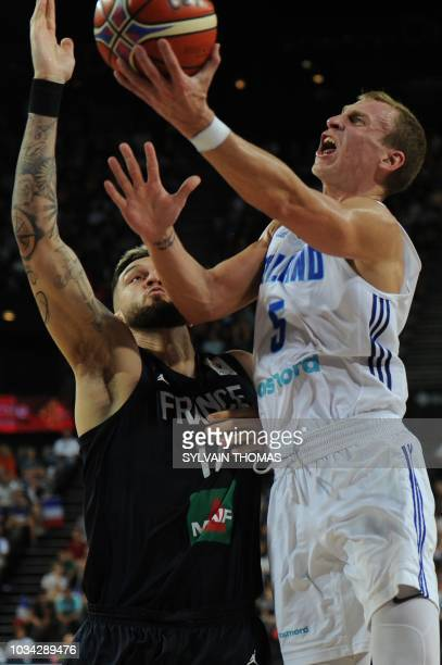 Finland's forward Alex Murphy vies with France's forward Vincent Poirier during the 2019 FIBA Basketball World Championship European qualifying group...