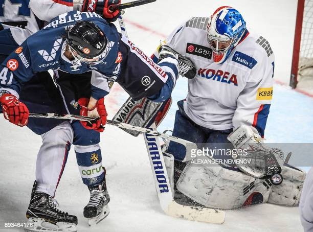Finland's forward Antti Pihlström attacks South Korea's goaltender Matthew Dalton during the Channel One Cup of the Euro Hockey Tour ice hockey match...
