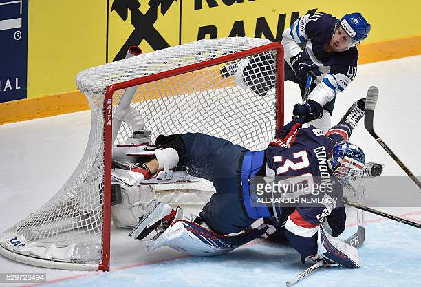 Finland's forward Antti Pihlstrom collides with US goalie Mike Condon during the group B preliminary round game Finland vs USA at the 2016 IIHF Ice...