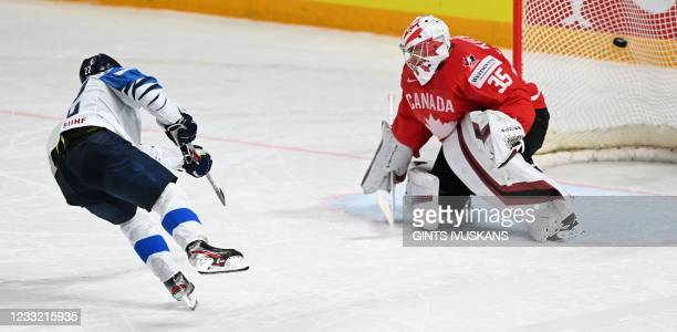 Finland's forward Arttu Ruotsalainen scores a goal past Canada's goalkeeper Darcy Kuemper during a shootout of the IIHF Men's Ice Hockey World...