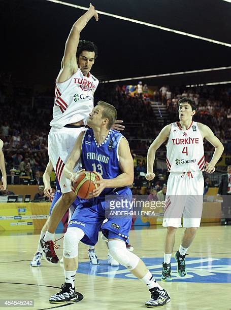 Finland's forward Hanno Mottola vies with Turkey's forward Kerem Gonlum during the 2014 FIBA World basketball championships group C match Turkey vs...