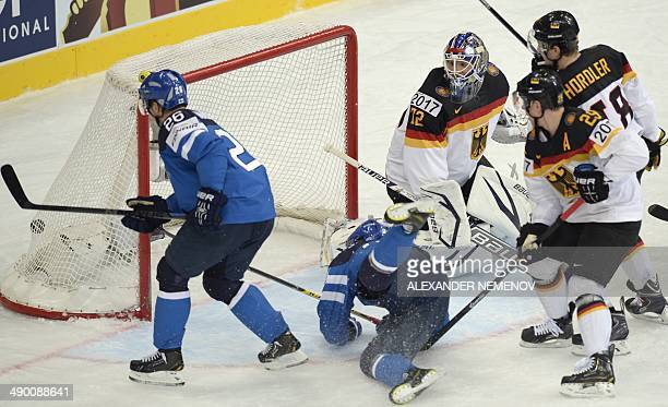 Finland's forward Jarkko Immonen scores during a preliminary round group B game Germany vs Finland of the IIHF International Ice Hockey World...