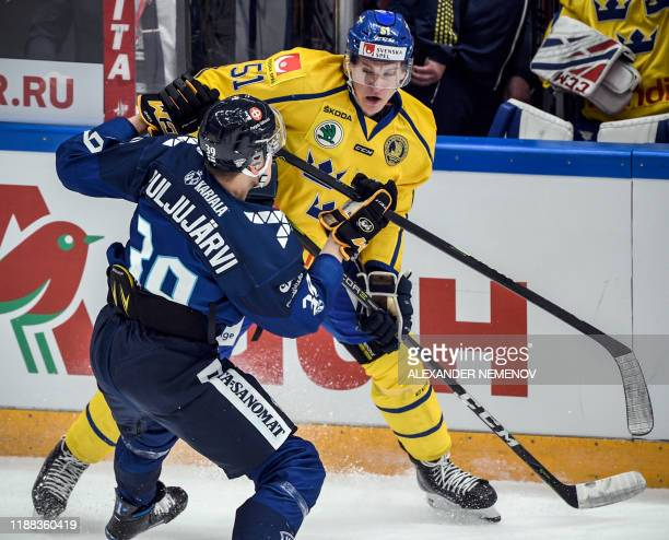 Finland's forward Jesse Puljujarvi vies with Sweden's forward Emil Sylvegard during the Channel One Cup of the Euro Hockey Tour ice hockey match...