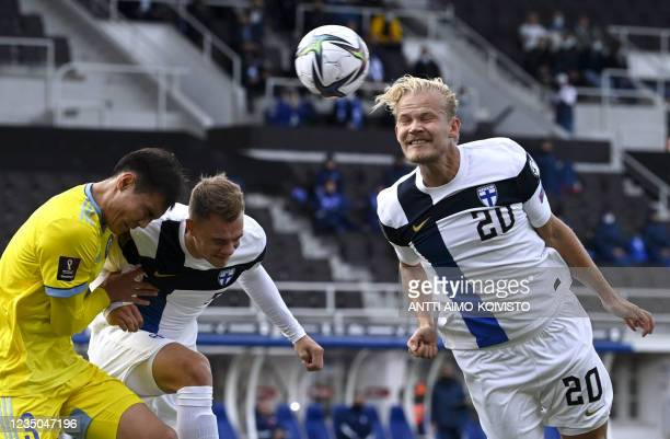Finland's forward Joel Pohjanpalo heads the ball during the FIFA World Cup Qatar 2022 qualification Group D football match between Finland and...