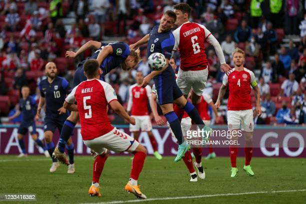 Finland's forward Joel Pohjanpalo scores a goal during the UEFA EURO 2020 Group B football match between Denmark and Finland at the Parken Stadium in...