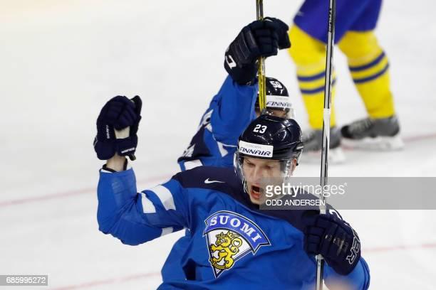Finland's forward Joonas Kemppainen celebrate scoring the 1-1 goal during the IIHF Men's World Championship Ice Hockey semi-final match between...